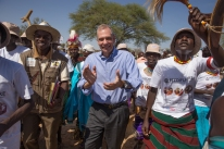 United States Ambassador to Kenya Bob Godec dances with residents of Napeikar after a meeting of the Napeikar Core Innovation Group in Turkana County on 29th March 2017. Through training carried out by the USAID Accelerated Value Chain Development and implemented by the International Livestock Research Institute in collaboration with the Turkana County Government, group members are equipped with improved livestock herd management knowledge. Photo Credit: USAID